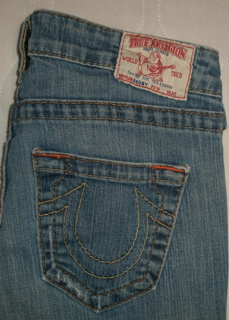 True Religion 5 Pocket Style * Zip Fly * Low Rise * Distressing Detail * Random Grindingand Destroyed Wear * Cotton/Spandex * Machine Boot Cut Jeans-Distressed