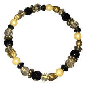 Black, white, clear, gold beaded bracelet