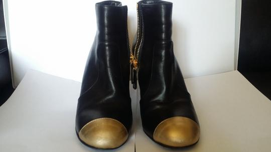 Chanel Black and gold Boots