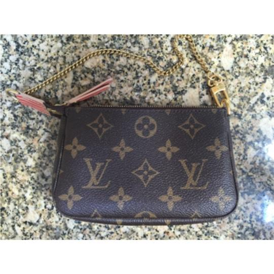 Louis Vuitton Limited Edition Mongram Rare Holiday Mini Collectors Wristlet in Brown