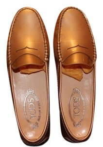 Tod's Rubber Moccasins Gold Flats