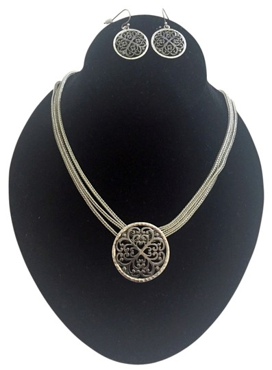Preload https://img-static.tradesy.com/item/5179480/silvertone-chain-with-a-matte-light-grey-swirl-design-necklace-and-earring-set-0-0-540-540.jpg