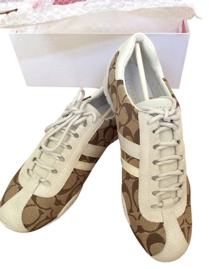 Preload https://item3.tradesy.com/images/coach-white-and-khaki-a1164-katelyn-fashion-sneakers-flats-size-us-75-regular-m-b-5182342-0-0.jpg?width=440&height=440