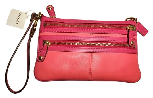 Preload https://item1.tradesy.com/images/coach-wristlet-coral-fuchsia-5189965-0-0.jpg?width=440&height=440