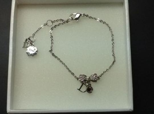 Preload https://item4.tradesy.com/images/dior-silver-bow-bracelet-5198-0-0.jpg?width=440&height=440