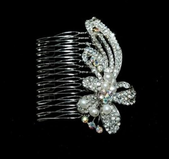 Preload https://item3.tradesy.com/images/silverrhodium-plate-rhinestone-comb-hair-accessory-52077-0-0.jpg?width=440&height=440