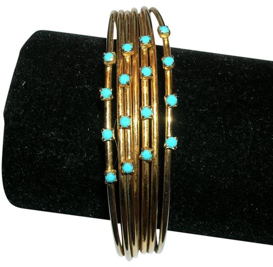 Preload https://item5.tradesy.com/images/gold-and-aqua-faux-turquoise-rhinestone-wire-strand-bangle-bracelet-521764-0-0.jpg?width=440&height=440