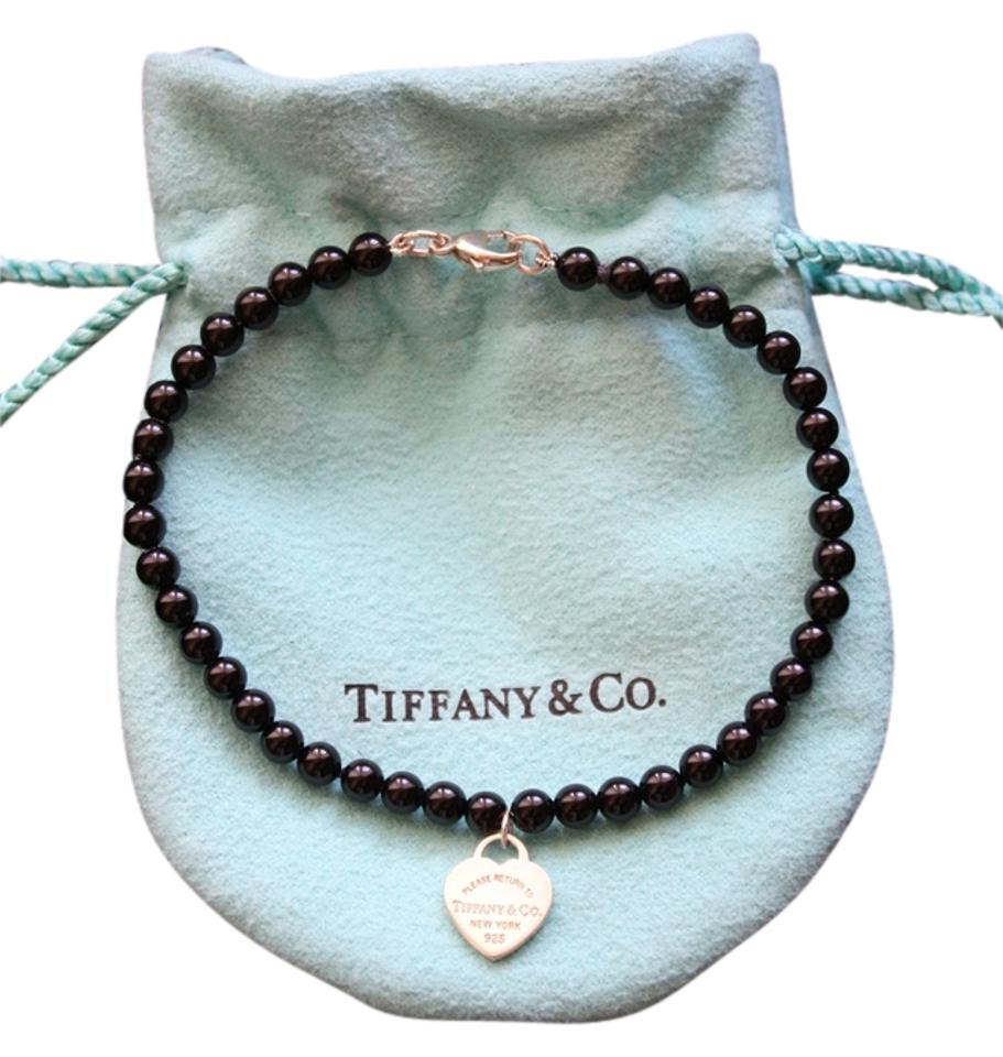 287ad682098919 Tiffany & Co. Onyx Return To Mini Heart Tag In Silver On A Black ...