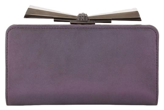 Preload https://item1.tradesy.com/images/judith-leiber-overture-carrie-bow-purple-leather-clutch-5223070-0-0.jpg?width=440&height=440