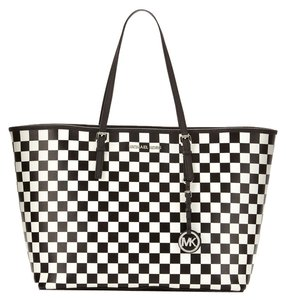 7a64c61f000069 Added to Shopping Bag. Michael Kors Tote in Black/White. Michael Kors  Medium Jet Set Checkerboard Travel Black/White Saffiano Leather Tote