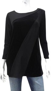 Sunny Leigh Polyester Spandex And Velvet Machine Washable. Imported. High Neckline. Pullover Style. Three-quarter Sleeves. Top BLACK