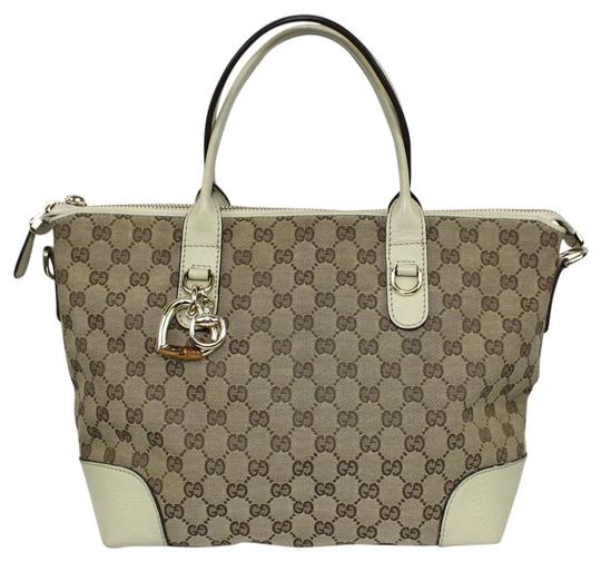 Preload https://item4.tradesy.com/images/gucci-heart-bit-beige-and-brown-canvas-tote-5257318-0-0.jpg?width=440&height=440
