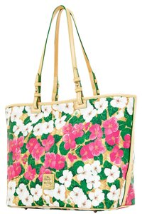 Dooney & Bourke Bright Tote in fushia and white flowers with green leaves.