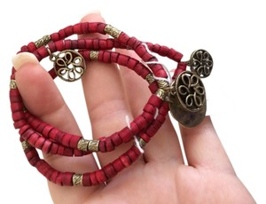 Cookie Lee Red wood beads with metallic charms -3 bracelets linked together