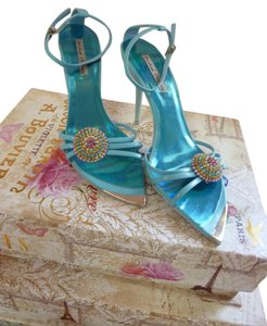 Michael Antonio Aqua color with silver heel and multi color medallion Sandals
