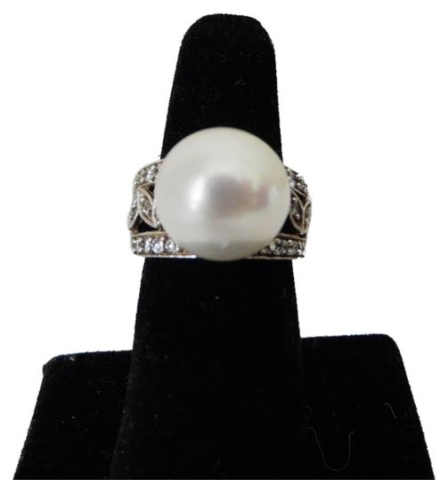 Preload https://item2.tradesy.com/images/pearlfection-925-sterling-silver-faux-white-south-sea-pearl-size-7-ring-5262391-0-0.jpg?width=440&height=440