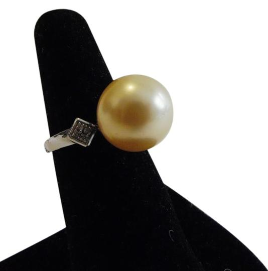Preload https://item4.tradesy.com/images/pearlfection-925-faux-golden-south-sea-pearl-size-8-ring-5262628-0-2.jpg?width=440&height=440