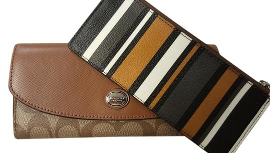 Preload https://item4.tradesy.com/images/coach-coach-signature-peyton-slim-stripe-wallet-w-pouch-5266663-0-0.jpg?width=440&height=440