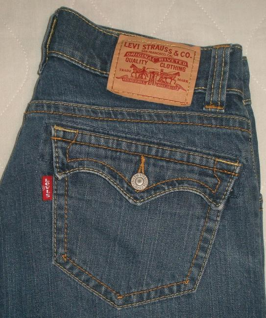 Levi's Back Flap Pockets * Low Rise * Opening * Zip Fly * Extended Waistband With Inner Button Closure * Whiskering Detail * Flare Leg Jeans-Medium Wash