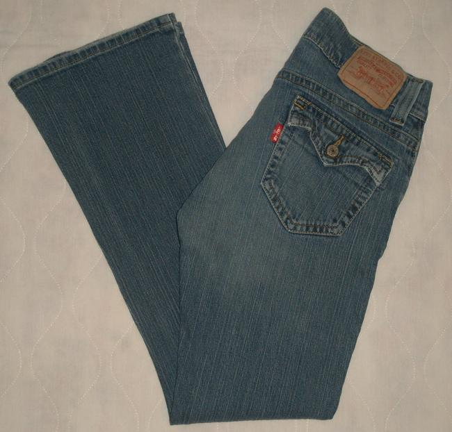 Levi's Back Flap Pockets * Zip Fly * Cotton/Spandex * Machine Washable * Low Rise * * Distressing Detail * Extended Waistband Flare Leg Jeans-Medium Wash