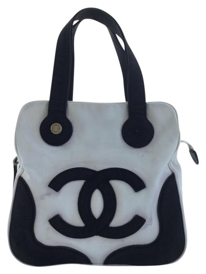 Preload https://item2.tradesy.com/images/chanel-white-and-black-canvas-satchel-5294536-0-2.jpg?width=440&height=440