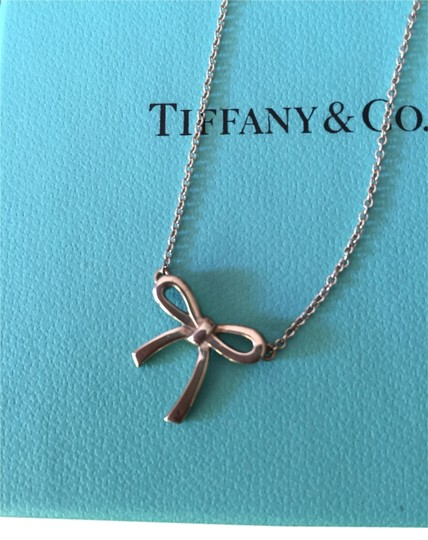 Preload https://item2.tradesy.com/images/tiffany-and-co-silver-with-a-bow-pendant-necklace-5296906-0-0.jpg?width=440&height=440