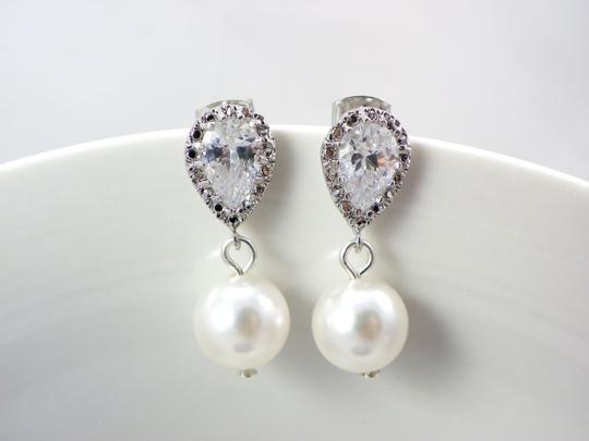 Preload https://img-static.tradesy.com/item/5306104/whiteivory-pearl-swarovski-pearls-cubic-zirconia-sterling-silver-posts-bridesmaid-gift-earrings-0-0-540-540.jpg