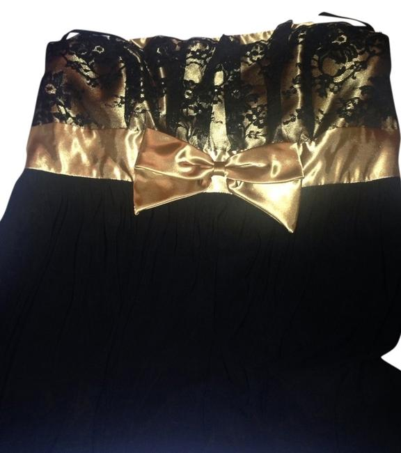 Preload https://item3.tradesy.com/images/jessica-mcclintock-black-and-gold-above-knee-cocktail-dress-size-14-l-530712-0-1.jpg?width=400&height=650