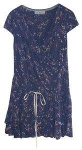 White Chocolate short dress Dark blue background floral on Tradesy