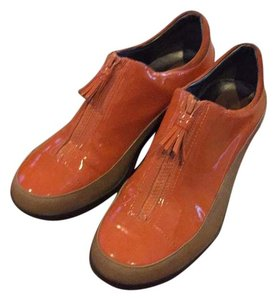 Cole Haan Orange patent with tan leather side. Mules