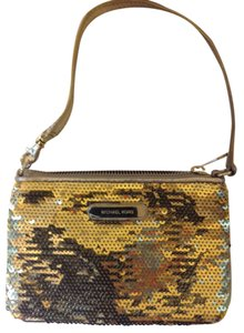 Michael Kors Wristlet in gold