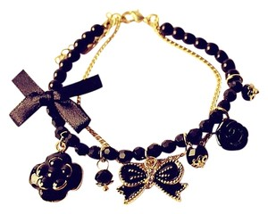 PRETTY BOW FLOWER CHARMS BRACELET BLACK