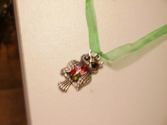 Other Owl on green ribbon necklace.