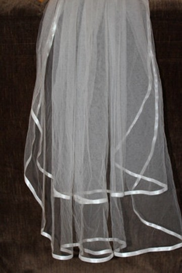 Preload https://item1.tradesy.com/images/ivory-medium-two-tier-35-ribbon-edge-bridal-veil-53765-0-0.jpg?width=440&height=440