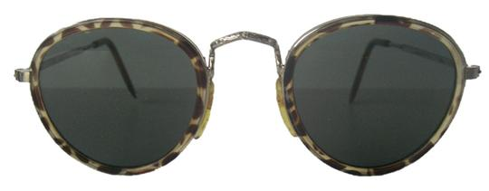 Preload https://item3.tradesy.com/images/silver-vintage-round-tortoise-frame-metal-temples-taiwan-vintage-1970s-sunglasses-5380597-0-0.jpg?width=440&height=440