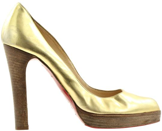 Preload https://img-static.tradesy.com/item/538456/christian-louboutin-gold-almond-toe-platform-pumps-size-eu-385-approx-us-85-regular-m-b-0-4-540-540.jpg