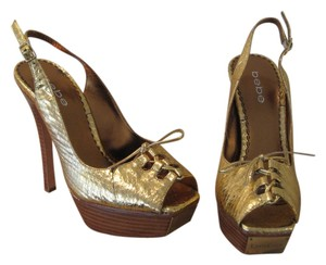 Bebe Gold Pumps
