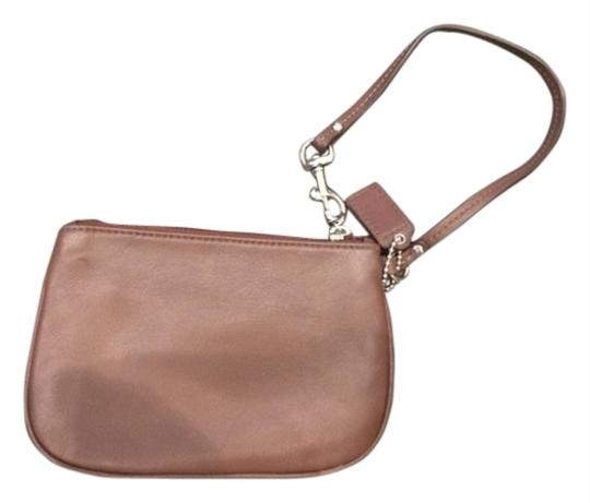 Preload https://item4.tradesy.com/images/coach-clutch-brown-leather-wristlet-5416513-0-0.jpg?width=440&height=440