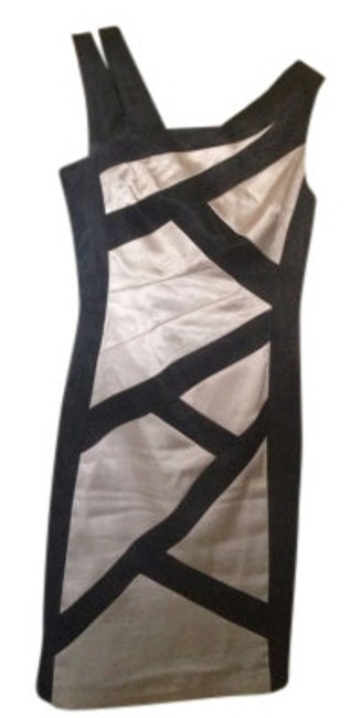 Preload https://item2.tradesy.com/images/london-times-black-and-ivory-above-knee-cocktail-dress-size-6-s-5426-0-0.jpg?width=400&height=650