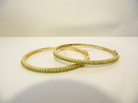 Preload https://item3.tradesy.com/images/technibond-925-peridot-hinged-bangle-size-7-bracelet-5434327-0-1.jpg?width=440&height=440
