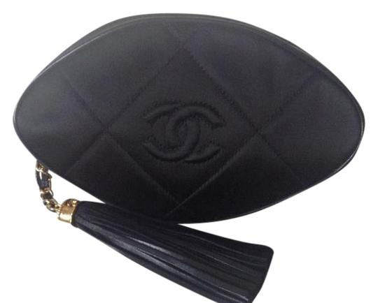 Preload https://item4.tradesy.com/images/chanel-clutch-quilted-with-tassel-pull-tab-black-silk-leather-clutch-5438143-0-1.jpg?width=440&height=440