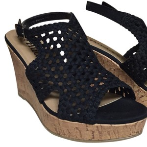 NWT and box Mudd black wedge sandel. Wedges