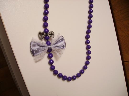 Other Unique beaded necklace with bows