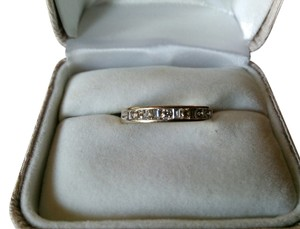 14k White gold band with .24 carats of diamonds.