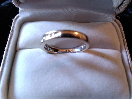 Other 14k White gold band with .24 carats of diamonds.