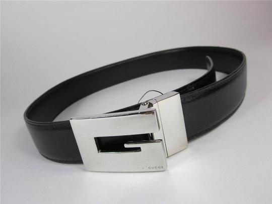 Gucci GUCCI: Black/Brown, Reversible Leather & Large Silver