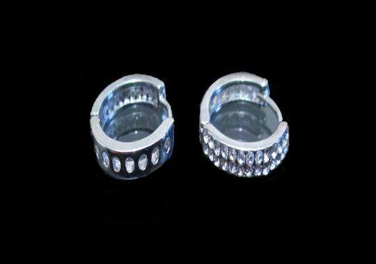 Preload https://item3.tradesy.com/images/clearrhodium-double-row-cz-huggie-earrings-546182-0-0.jpg?width=440&height=440