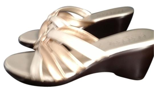 Preload https://item1.tradesy.com/images/other-brown-heel-gold-and-pewter-color-sandals-5476780-0-0.jpg?width=440&height=440