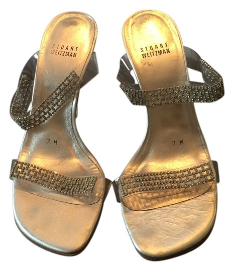 Preload https://item2.tradesy.com/images/stuart-weitzman-silver-clear-heal-formal-shoes-size-us-75-5479396-0-0.jpg?width=440&height=440