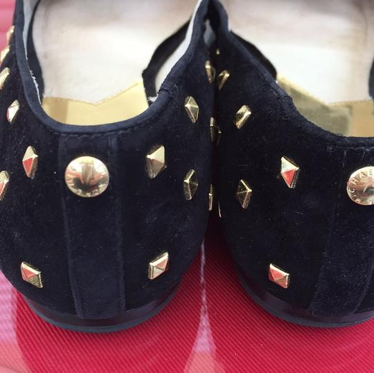 Michael kors flats with gold studs black suede. Missing a couple of studs bit its not that noticable. Flats